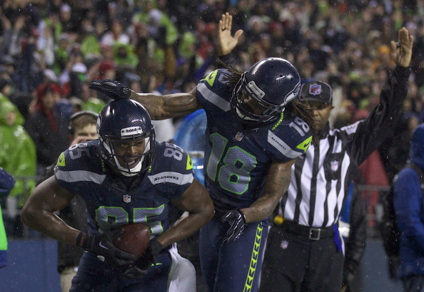 SEATTLE, WA - DECEMBER 23: Anthony McCoy #85 of the Seattle Seahawks celebrates scoring a touchdown against the San Francisco 49ers with teammate Sidney Rice #18 during a game at CenturyLink Field on December 23, 2012 in Seattle, Washington. (Photo by Stephen Brashear/Getty Images)