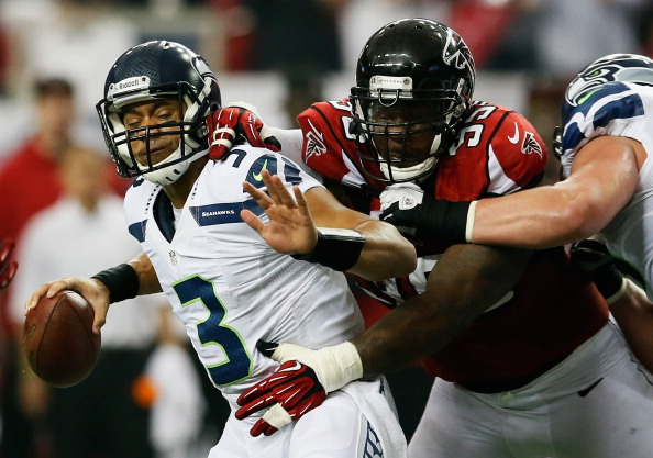 ATLANTA, GA - JANUARY 13: Jonathan Babineaux #95 of the Atlanta Falcons sacks Russell Wilson #3 of the Seattle Seahawks in the second quarter during the NFC Divisional Playoff Game at Georgia Dome on January 13, 2013 in Atlanta, Georgia. (Photo by Kevin C. Cox/Getty Images)