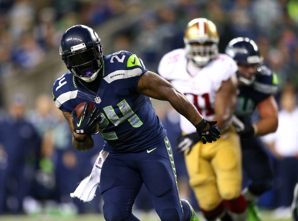 SEATTLE - SEPTEMBER 15:  Marshawn Lynch #24 of the Seattle Seahawks runs the ball against the San Francisco 49ers on September 15, 2013 at Century Link Field in Seattle, Washington.  (Photo by Jonathan Ferrey/Getty Images)
