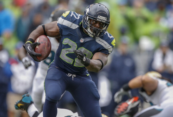 SEATTLE, WA - SEPTEMBER 22:  Running back Robert Turbin #22 of the Seattle Seahawks rushes against the Jacksonville Jaguars at CenturyLink Field on September 22, 2013 in Seattle, Washington.  (Photo by Otto Greule Jr/Getty Images)