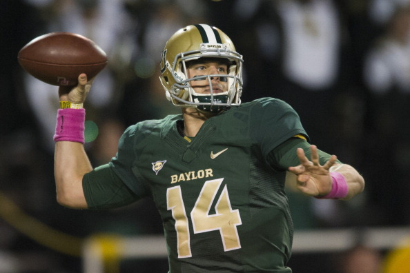 WACO, TX - OCTOBER 19: Bryce Petty #14 of the Baylor Bears drops back to throw a pass against the Iowa State Cyclones on October 19, 2013 at Floyd Casey Stadium in Waco, Texas.  (Photo by Cooper Neill/Getty Images)