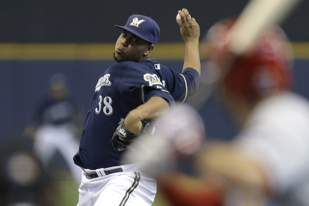 MILWAUKEE, WI - APRIL 16: Wily Peralta #38 of the Milwaukee Brewers pitches during the fourth inning against the St. Louis Cardinals at Miller Park on April 16, 2014 in Milwaukee, Wisconsin.