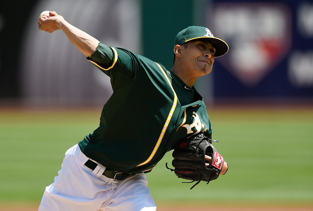 OAKLAND, CA - APRIL 20:  Jesse Chavez #60 of the Oakland Athletics pitches against the Houston Astros in the top of the first inning at O.co Coliseum on April 20, 2014 in Oakland, California.