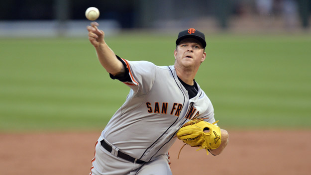 CHICAGO, IL - JUNE 17:  Starting pitcher Matt Cain #18 of the San Francisco Giants delivers a pitch during the second inning against the Chicago White Sox at U.S. Cellular Field on June 17, 2014 in Chicago, Illinois.  (Photo by Brian Kersey/Getty Images)