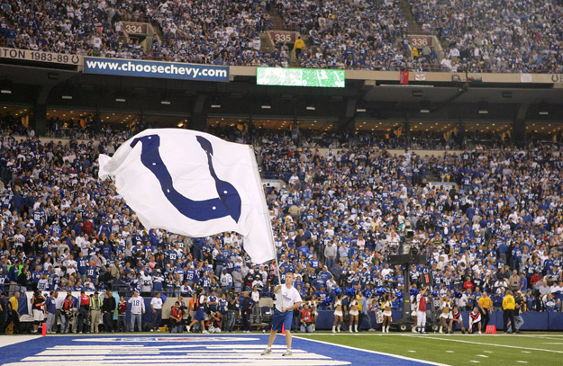 INDIANAPOLIS - NOVEMBER 04:  A flag with the logo of the Indianapolis Colts is waved in front of fans in the endzone against the New England Patriots on November 4, 2007 at the RCA Dome in Indianapolis, Indiana. The Patriots won 24-20. (Photo by Andy Lyons/Getty Images)