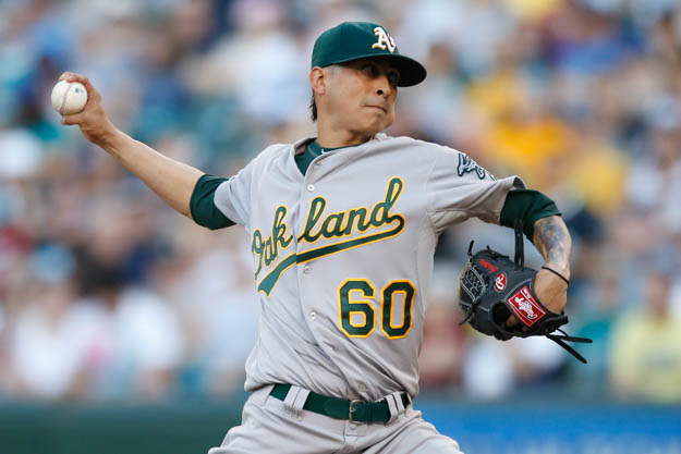 SEATTLE, WA - JULY 12:  Starting pitcher Jesse Chavez #60 of the Oakland Athletics pitches in the first inning against the Seattle Mariners at Safeco Field on July 12, 2014 in Seattle, Washington.