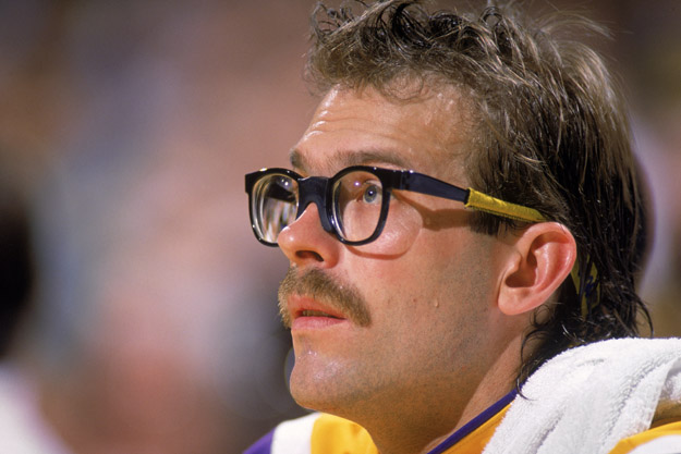LOS ANGELES - 1987:  Kurt Rambis #31 of the Los Angeles Lakers sits on the bench during an NBA game at the Great Western Forum in Los Angeles, California in 1987.