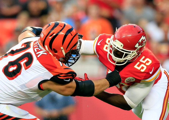 Dee Ford #55 of the Kansas City Chiefs is blocked by David King #76 of the Cincinnati Bengals defends during the preseason game at Arrowhead Stadium on August 7, 2014 in Kansas City, Missouri.  (Photo by Jamie Squire/Getty Images)