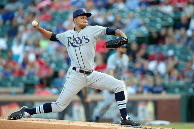 ARLINGTON, TX - AUGUST 13: Chris Archer #22 of the Tampa Bay Rays throws in the first inning against the Texas Rangers at Globe Life Park in Arlington on August 13, 2014 in Arlington, Texas.