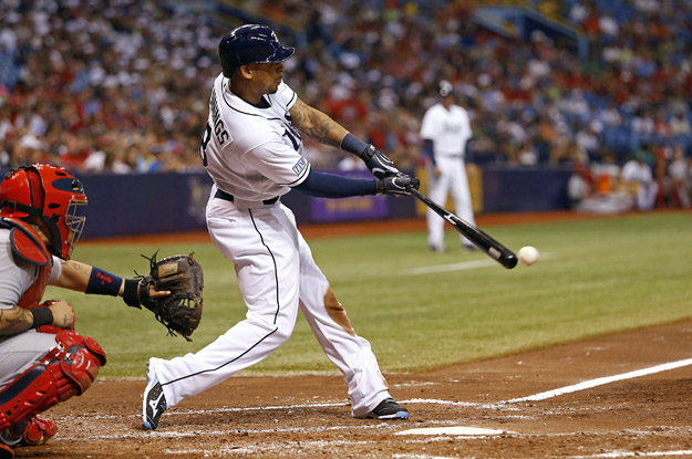 ST. PETERSBURG, FL - JUNE 10:  Desmond Jennings #8 of the Tampa Bay Rays grounds into the double play in front of catcher Yadier Molina #4 of the St. Louis Cardinals during the fifth inning of a game on June 10, 2014 at Tropicana Field in St. Petersburg, Florida.