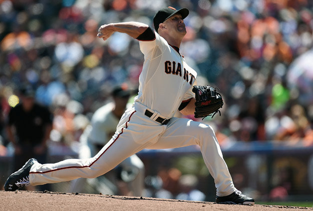 SAN FRANCISCO, CA - AUGUST 16:  Tim Hudson #17 of the San Francisco Giants pitches against the Philadelphia Phillies in the top of the first inning at AT&T Park on August 16, 2014 in San Francisco, California.
