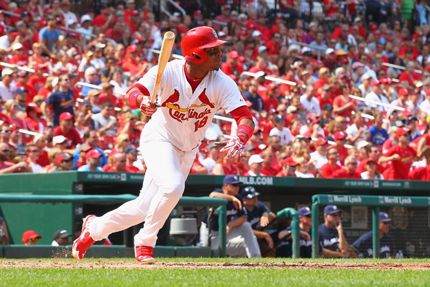 ST. LOUIS, MO - AUGUST 3:  Oscar Taveras #18 of the St. Louis Cardinals hits what would be the game-winning RBI single against the Milwaukee Brewers in the seventh inning at Busch Stadium on August 3, 2014 in St. Louis, Missouri.  The Cardinals beat the Brewers 3-2.