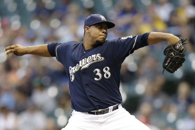 MILWAUKEE, WI - SEPTEMBER 04: Wily Peralta #38 of the Milwaukee Brewers pitches during the first inning against the St. Louis Cardinals at Miller Park on September 04, 2014 in Milwaukee, Wisconsin.