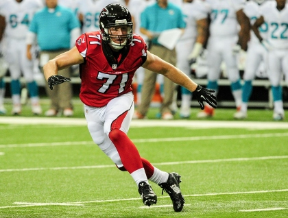 Kroy Biermann #71 of the Atlanta Falcons watches the runner in the first quarter of a preseason game against the Miami Dolphins at the Georgia Dome on August 8, 2014 in Atlanta, Georgia. (Photo by Scott Cunningham/Getty Images)