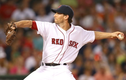 BOSTON, MA - JULY 27:  Craig Breslow #32 of the Boston Red Sox throws in relief in the fifth inning against the Chicago White Sox at Fenway Park on July 27, 2015 in Boston, Massachusetts.  (Photo by Jim Rogash/Getty Images)