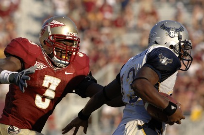 Florida State freshman safety Myron Rolle chases Rice quarterback Joel Armstrong   September 23, 2006 at Doak Campbell Stadium in Tallahassee.  The Seminoles defeated the Owls 55 - 7. (Photo by A. Messerschmidt/Getty Images) *** Local Caption ***