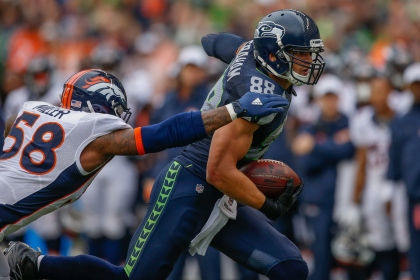 SEATTLE, WA - AUGUST 14:  Tight end Jimmy Graham #88 of the Seattle Seahawks rushes against linebacker Von Miller #58 of the Denver Broncos at CenturyLink Field on August 14, 2015 in Seattle, Washington.  (Photo by Otto Greule Jr/Getty Images)