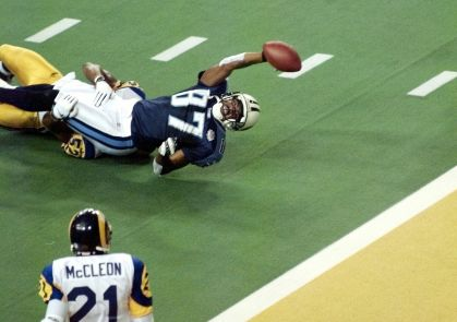 ATLANTA, GA - JANUARY 30: Tennessee Titans wide receiver Kevin Dyson stretches for the end zone but falls short as he is tackled by St. Louis Rams linebacker Mike Jones as time runs out in Super Bowl XXXIV at the Georgia Dome in Atlanta, GA 30 January, 2000. The Rams defeated the Tennessee Titans 23-16 (ELECTRONIC IMAGE) (Photo credit should read PETER NEWCOMB/AFP/Getty Images)