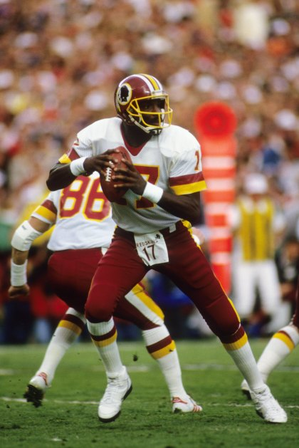 SAN DIEGO - JANUARY 31: Quarterback Doug Williams #10 of the Washington Redskins drops back to pass during Super Bowl XXII against the Denver Broncos at Jack Murphy Stadium on January 31, 1988 in San Diego, California. The Redskins won 42-10. (Photo by George Rose/Getty Images)