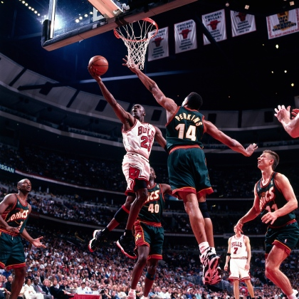 CHICAGO - JUNE 7: Michael Jordan #23 of the Chicago Bulls drives to the basket for a layup against the Seattle Sonics during Game two of the 1996 NBA Finals at United Center on June 7, 1996 in Chicago, Illinois. The Bulls won 92-88. NOTE TO USER: User expressly acknowledges and agrees that, by downloading and/or using this Photograph, user is consenting to the terms and conditions of the Getty Images License Agreement. Mandatory Copyright Notice: Copyright 1996 NBAE (Photo by Barry Gossage/NBAE via Getty Images)