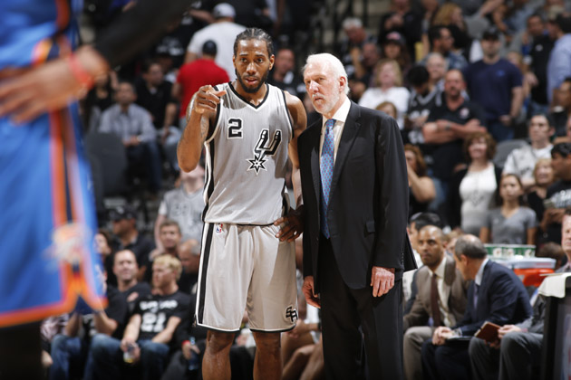 Kawhi Leonard #2 speaks with head coach, Gregg Popovich of the San Antonio Spurs during the game against the Oklahoma City Thunder.